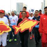 Menteri Susi Kampanyekan Gerakan Indonesia Gemar Makan Ikan Bersama Atlet Asean Games